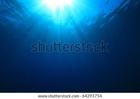 Sun rays in the blue sea