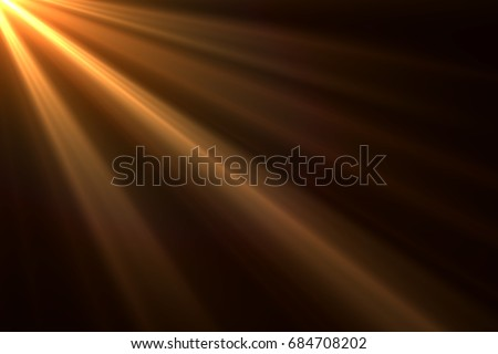 Photo of  Sun rays light isolated on black background for overlay design