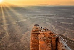 Sun rays on Edge of the World, a natural landmark and popular tourist destination near Riyadh -Saudi Arabia.