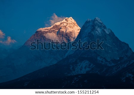 Sun rays on the mount Ama Dablam (6814 m) at sunset. Himalayas. Nepal