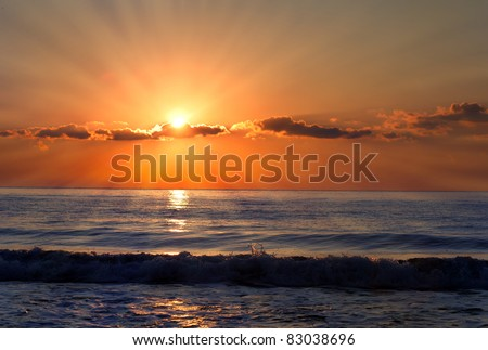 Sun rays over the bulgarian Black sea; Morning seascape with nice clouds.