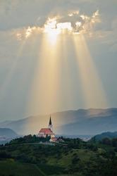 Sun rays shining down on a Church