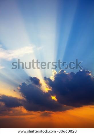 Sun rays through clouds