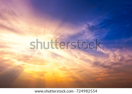 Sun rays with beautiful clouds and sky at sunset. #724982554