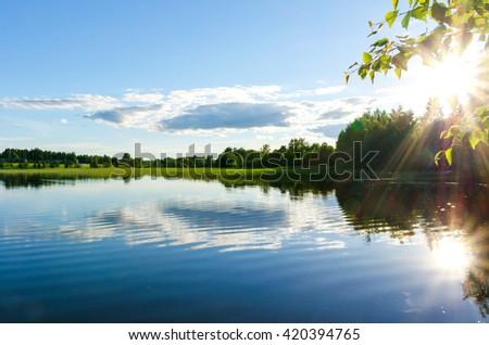 Sun reflected in the lake, Finland. #420394765