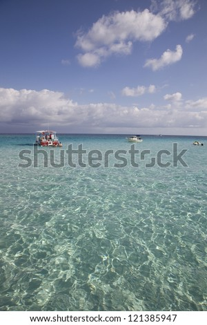 Sun reflecting on the beautiful clear tropical waters at Stingray City, Cayman Islands.
