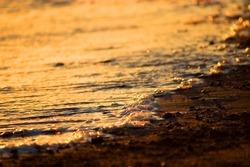 sun reflection on ocean waves. close up background