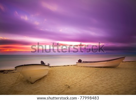 Sun rise on violet sky with boat
