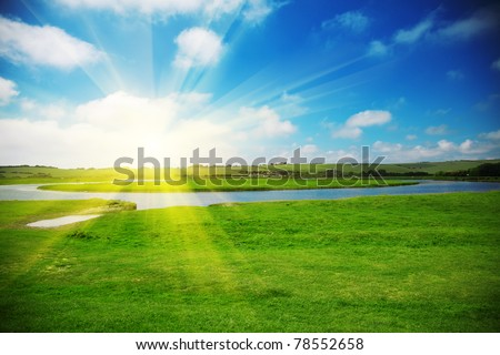 Sun rising above a beautiful field in countryside #78552658