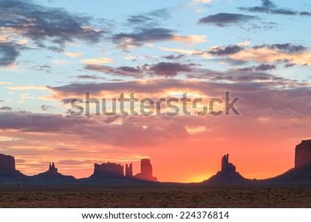 Sun rising above horizon at Monument Valley Navajo Tribal Park #224376814