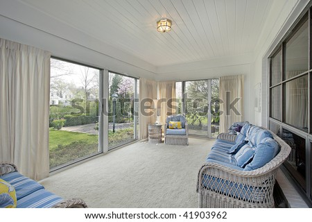 Sun room in suburban home with patio view