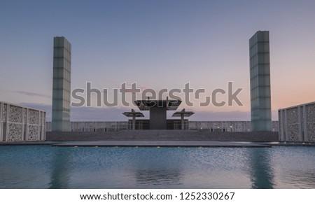 sun set at building from Qatar foundation Doha,Qatar
