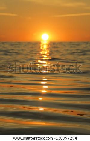 sun set behind the sea