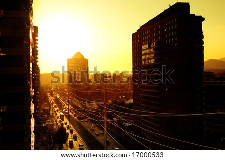 Sun sets over a busy Santiago cityscape
