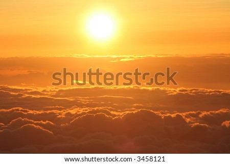 Sun setting above the clouds at 14,000 feet on Mauna Kea,  Hawaii