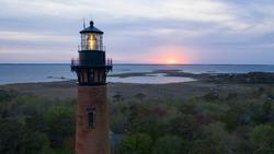 Sun Setting at Currituck Lighthouse Outer Banks North Carolina