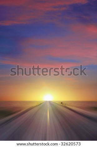 Sun setting at thte end of a straight two lane highway cutting through a flat expanse of desert wasteland and vanishing to a point on the horizon