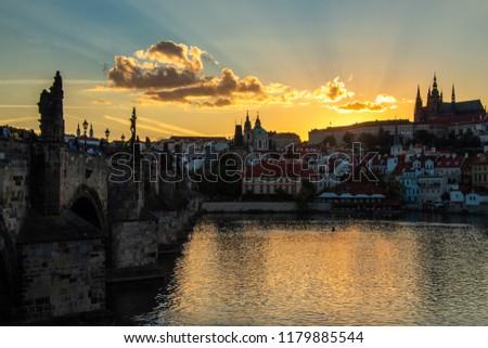 Sun setting down at the Charles bridge, Prague. #1179885544