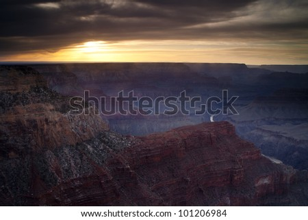 Sun setting in Grand Canyon National Park as viewed from the Hopi Point overlook on the western end of the canyon's South Rim.  The Colorado River can been seen in the distance.