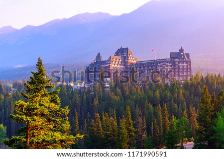 Sun setting on historic Banff Springs Hotel nestled in the Canadian Rockies of Banff National Park. Built in the 19th century, it was designated a National Historic Site by Canada in 1988.