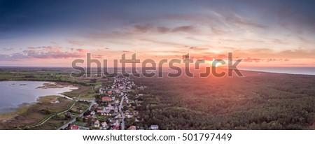 Sun setting over a small seaside village K?ty Rybackie, Poland Stock fotó ©