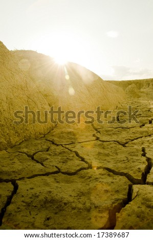 Sun setting over arid land