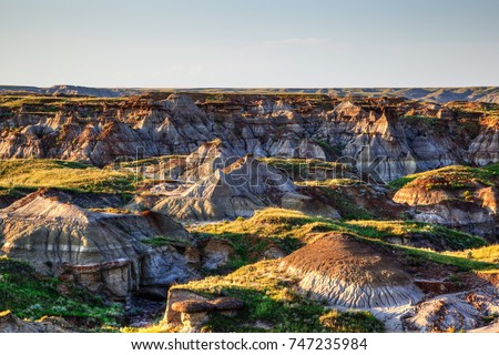 Sun setting over Dinosaur Provincial Park, a UNESCO World Heritage Site in Alberta, Canada. The Alberta badlands is well known for being one of the richest dinosaur fossil locales in the world.
