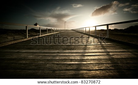 Sun setting over jetty on the Australian coastline