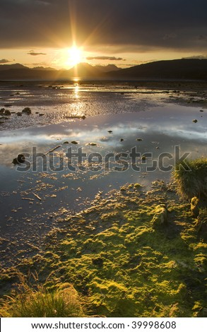 Sun setting over River Clyde at Cardross near Glasgow in Scotland
