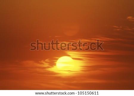 Sun Setting Through Clouds