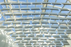 Sun shade or sun reflector, shades the building from the sun. Beautiful white reflectors. Technical panels.