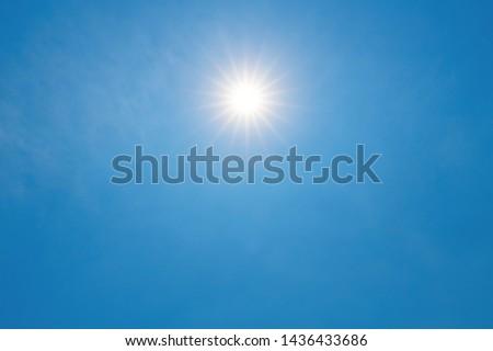 Sun shines in blue sky amid beautiful cloud. #1436433686