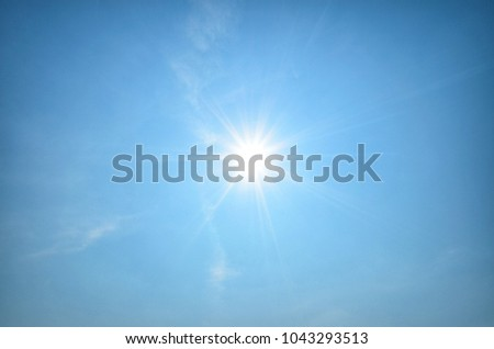 Sun shines in blue sky amid beautiful cloud. Concept is sun still shining. Life is always hopeful. #1043293513