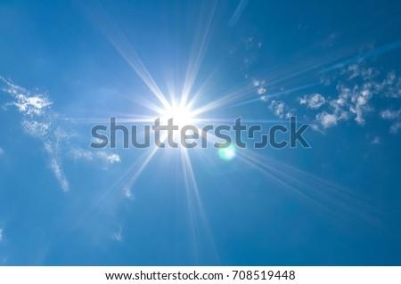 Sun shines in blue sky amid beautiful cloud. Concept is sun still shining. Life is always hopeful. #708519448