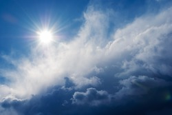sun shining above beautiful stormy clouds, sky is clearing after rain