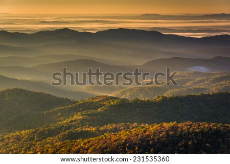 Sun shining through fog in the valley, seen from Beacon Heights, along the Blue Ridge Parkway near Blowing Rock, North Carolina.