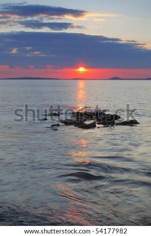 sun sinks to horizon on Irelands West Coast at Rosses Point, Co.Sligo, Ireland
