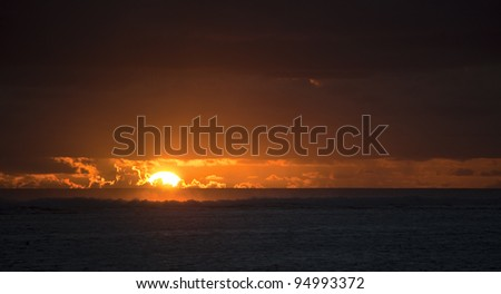 Sun sinks to Sea - Behind Coral Reef of Rarotonga, Cook Islands, Polynesia