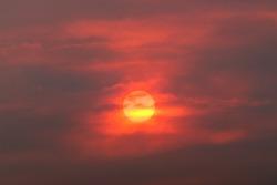 sun through smoke from wildfire