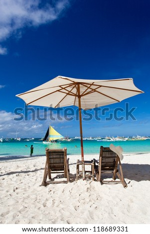 Sun umbrella with Sun Hat on chair