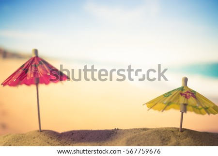 Sun umbrellas on a sandy beach #567759676