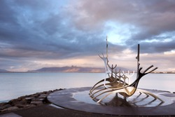 Sun Voyager monument, clouds, landmark of Reykjavik city.