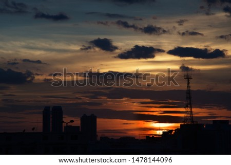 Sun with antenna tower in foreground in twilight time