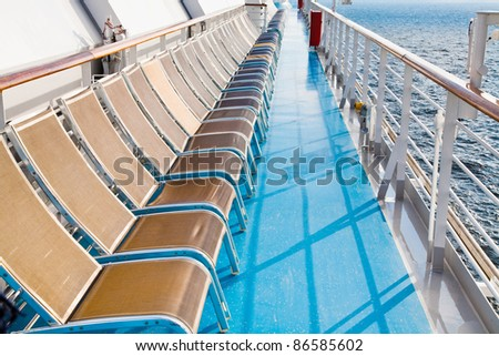 sunbath chairs on side of cruise liner