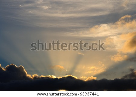 Sunbeam busts through clouds like a heavenly image of bright light