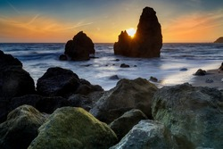 Sunbeam through sea stacks at Rodeo Beach. Marin County, California, USA.