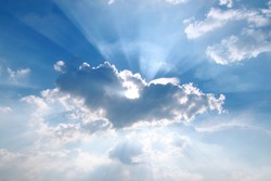 Sunbeam  through the haze on blue sky: can be used as background and dramatic look