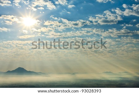 Sunbeams in the misty morning over  mountain in northeast of Thailand
