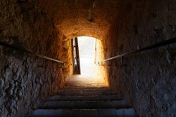 Sunbeams passing through Traditional stairway up to antique Fortress Burg Roquebrune-Cap-Martin, France.