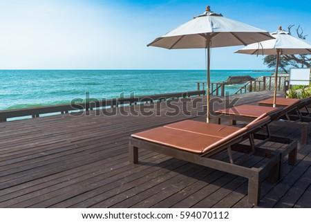 Sunbeds near the Sea #594070112